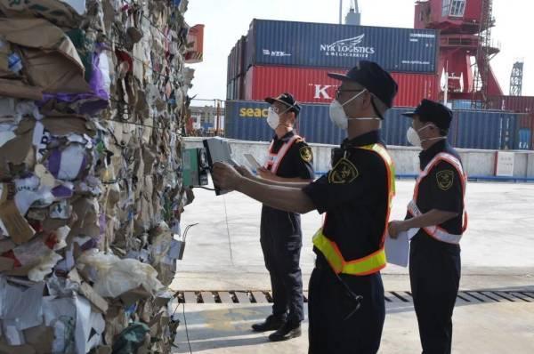 观察者网夹杂物含量0.53%,江门海关退运出境104.12吨固体废物