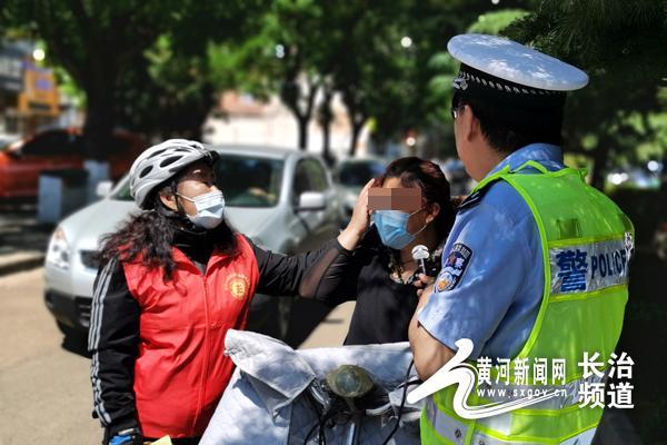 黄河新闻网长治频道长治交警携手正能量公益协会开展文明交通劝导活动